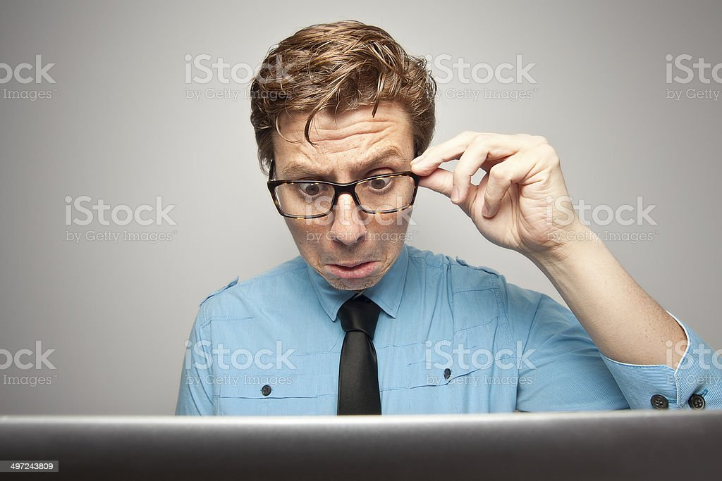 Confused Nerd with Laptop stock photo