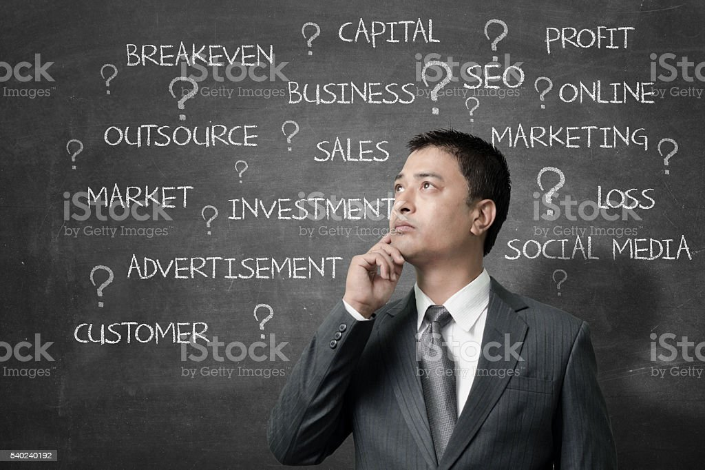 Confused newbie businessman stock photo