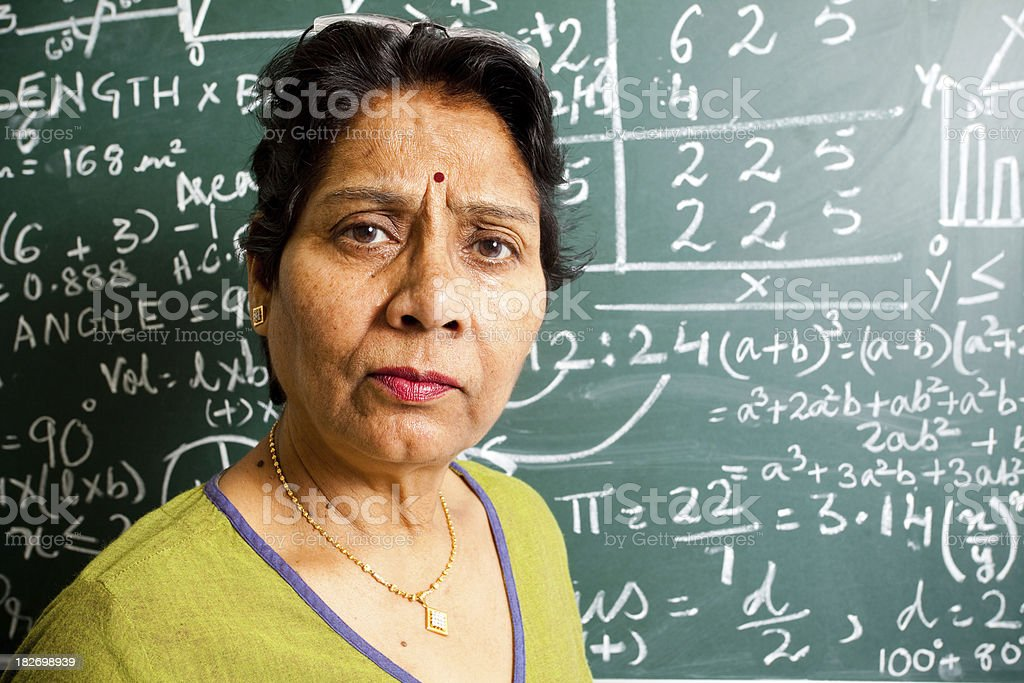 Confused Senior Indian Mathematics Teacher in a Classroom royalty-free stock photo