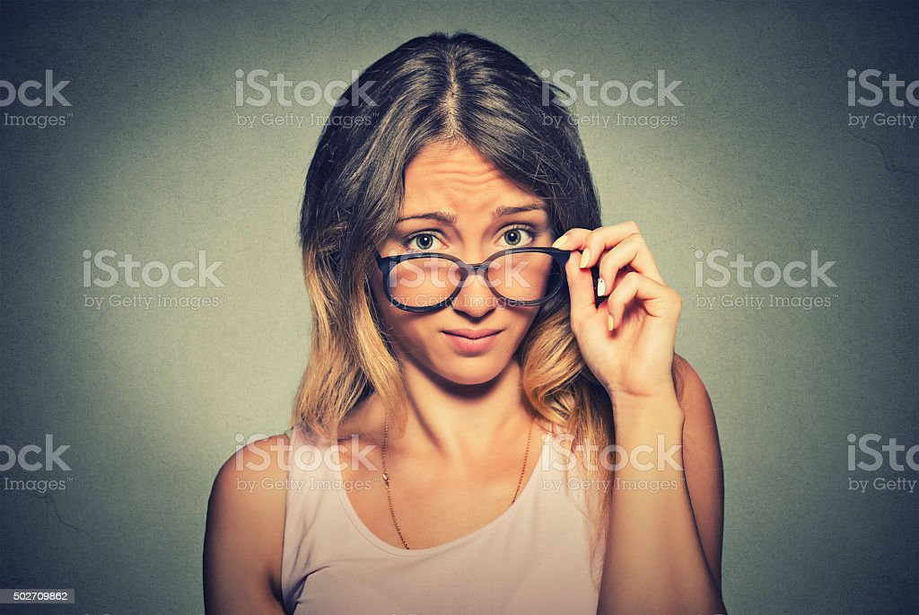confused skeptical woman looking at you with disapproval stock photo