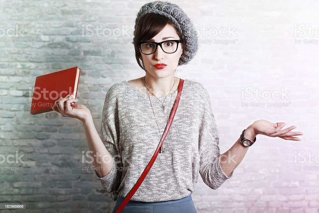Confused student holding a book stock photo