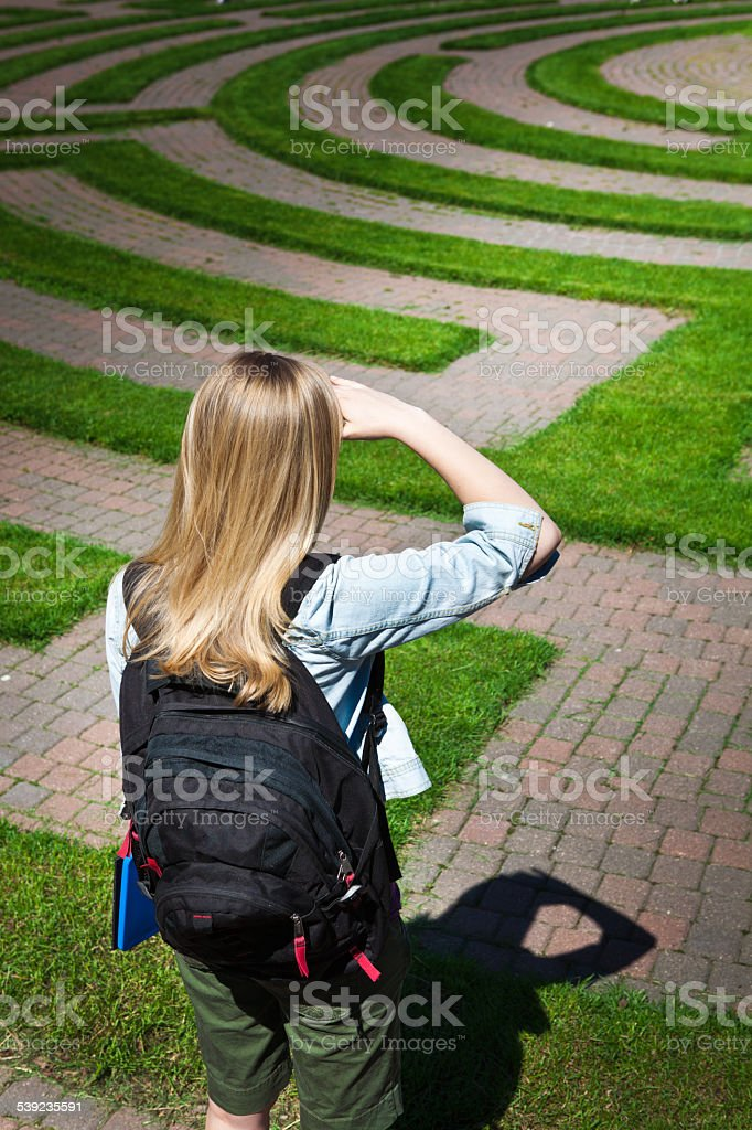 Confused Teenage Student in the Puzzle Maze of Education stock photo
