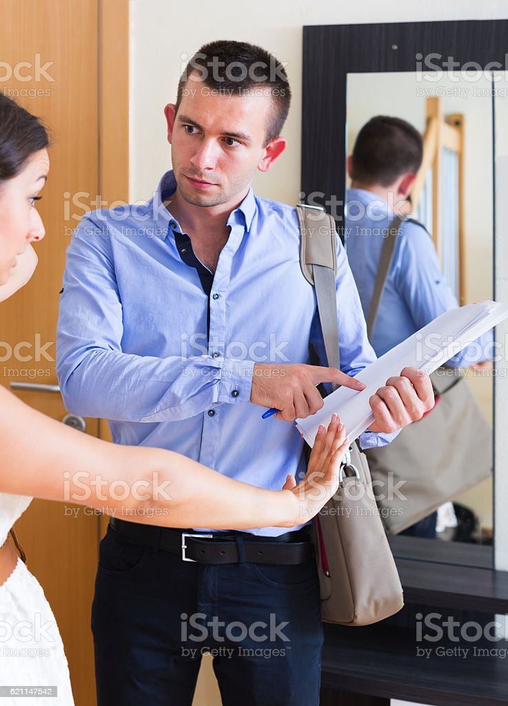 Confused tenant and furious landlord stock photo