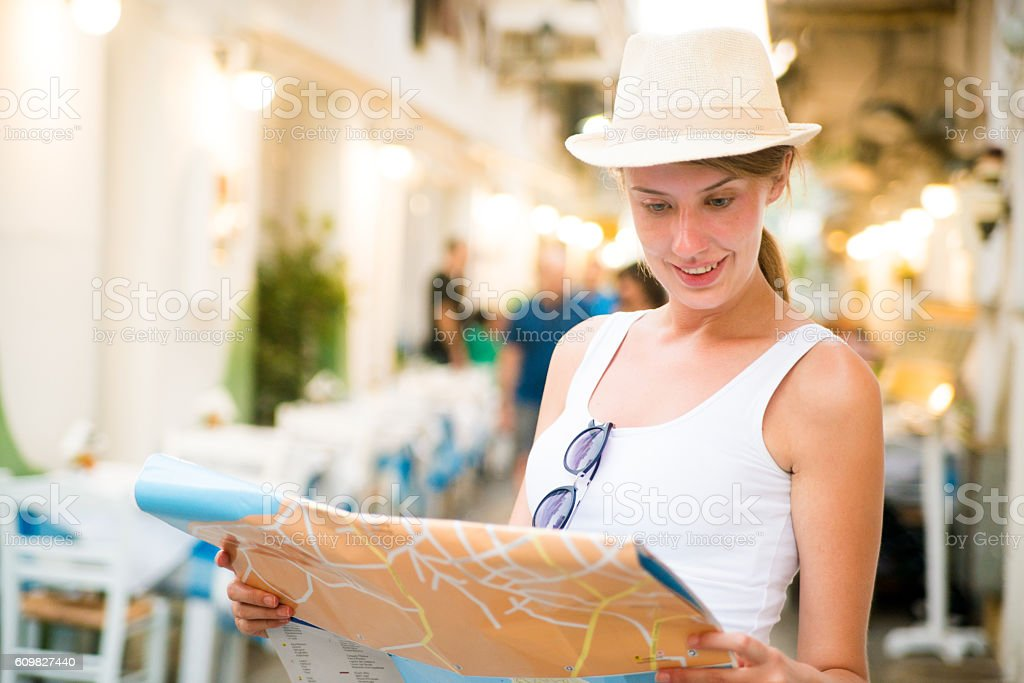 confused tourist on the street looking at a map stock photo