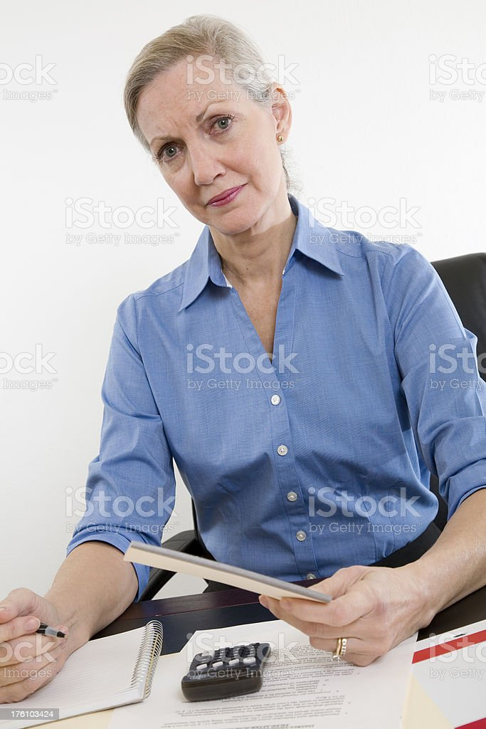 Confused Woman Having House Financial Problems royalty-free stock photo