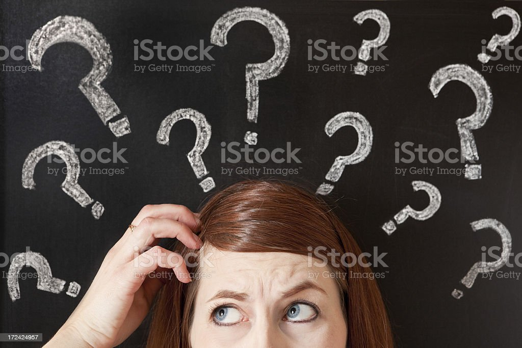 Confused Woman Scratching Her Head stock photo