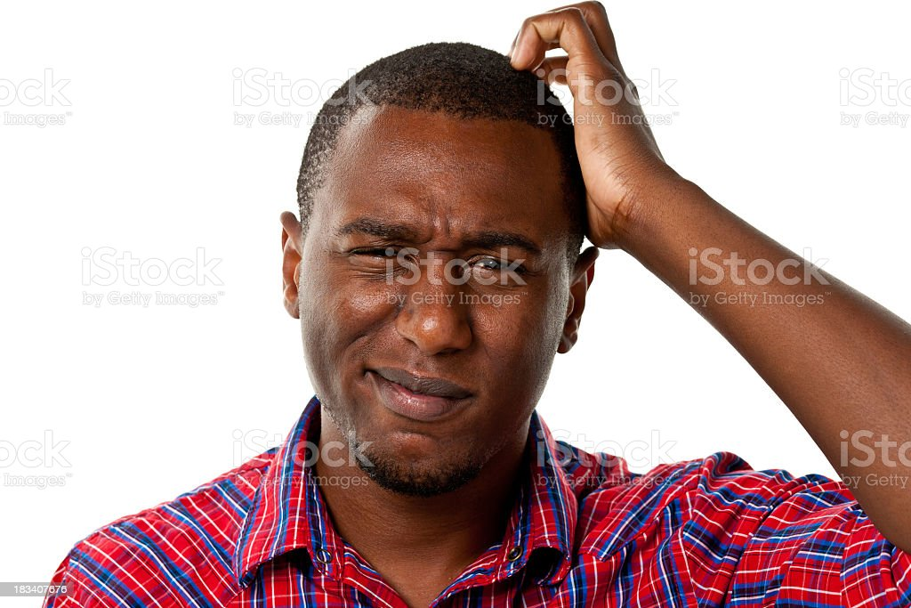 Confused young male scratching his head royalty-free stock photo