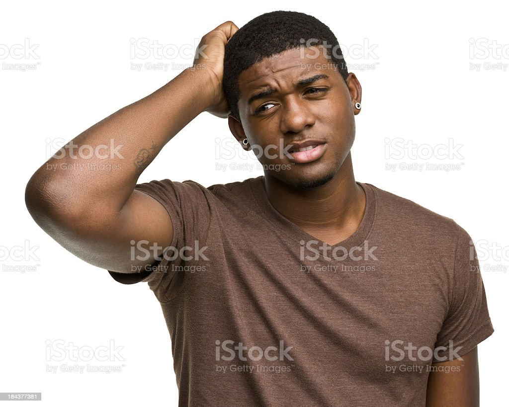 Confused Young Man Scratches His Head royalty-free stock photo