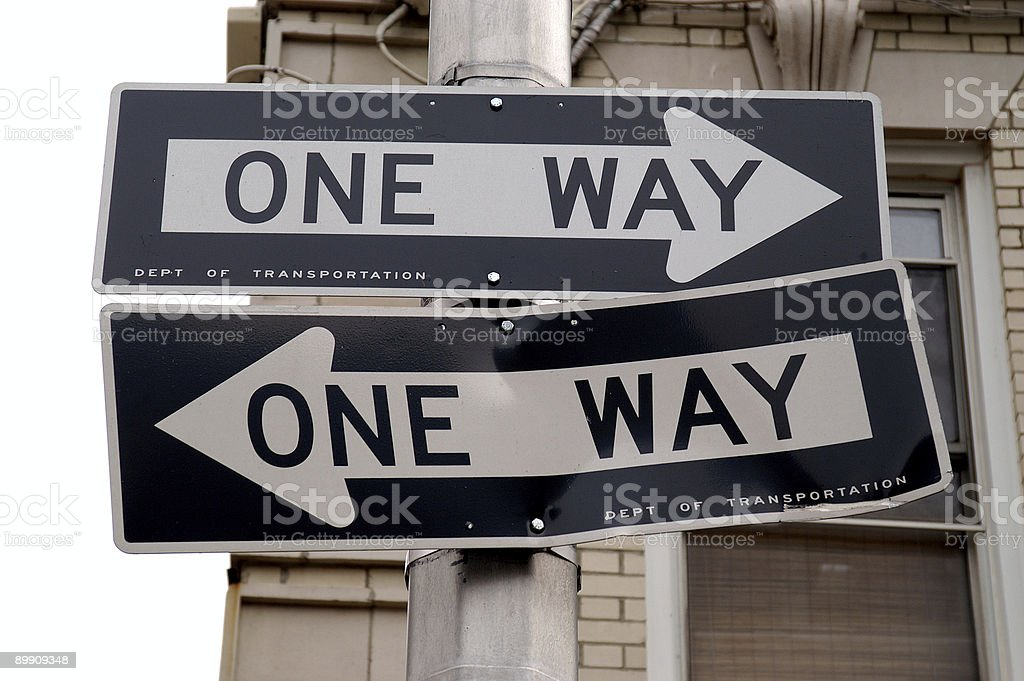 confusing one-way signs stock photo