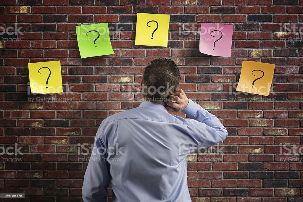Confusion and question marks stock photo