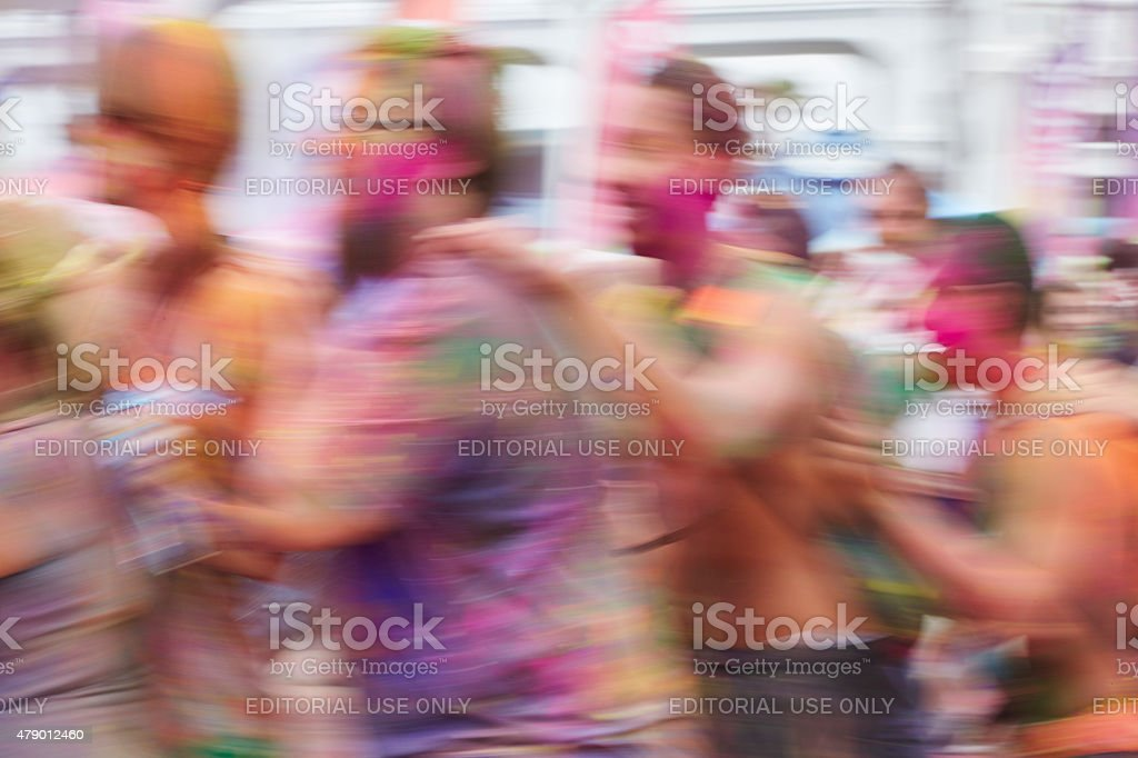 Conga Line Dancing at Holi Festival of Color stock photo