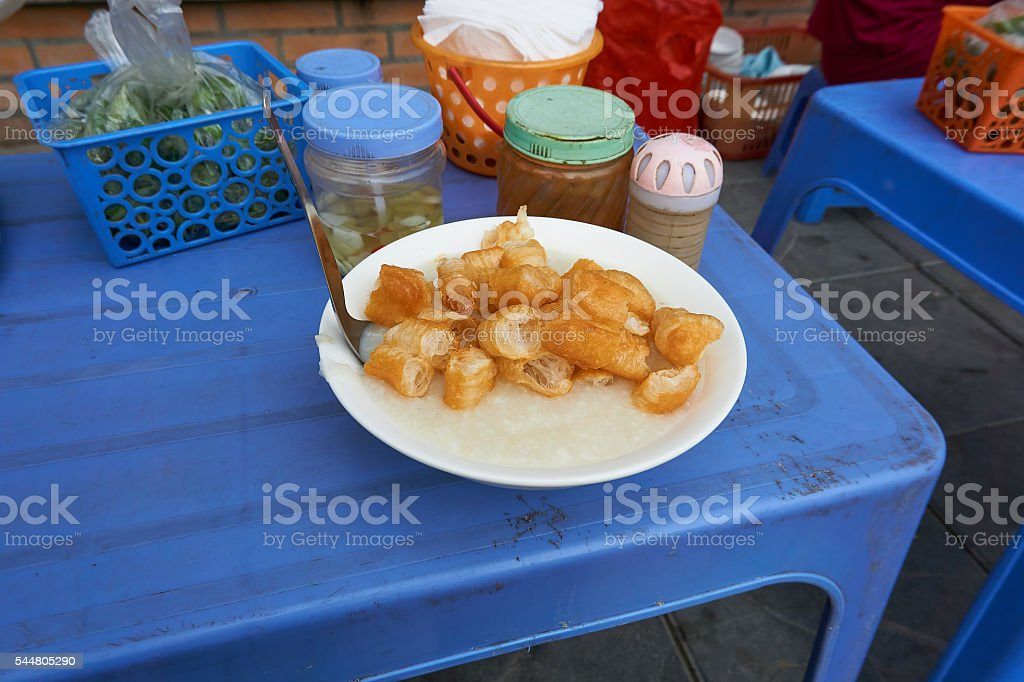 Congee with Donuts at Street Food Stall Hanoi Vietnam stock photo
