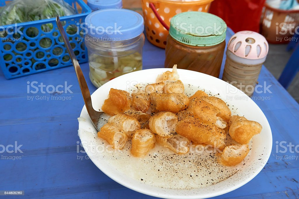 Congee with Pepper and Donuts at Street Hanoi Vietnam stock photo