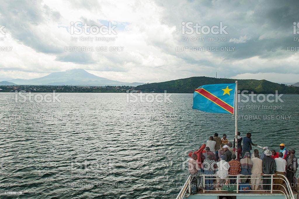 Congolese boat on Lake Kivu is approaching Goma stock photo