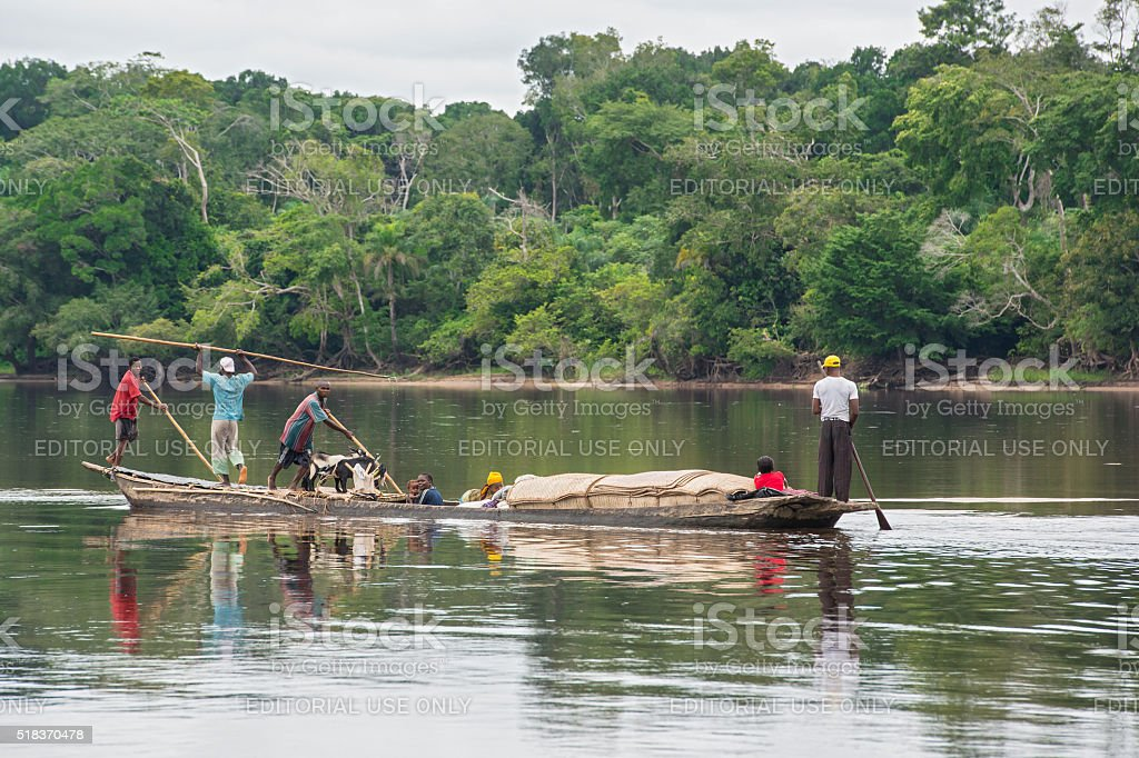 Congolese family in their pirogue on Congo River stock photo