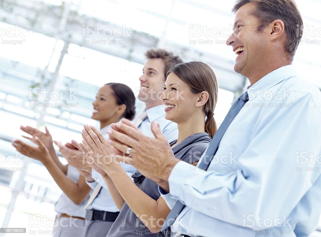 Congratulating a colleague with his promotion royalty-free stock photo