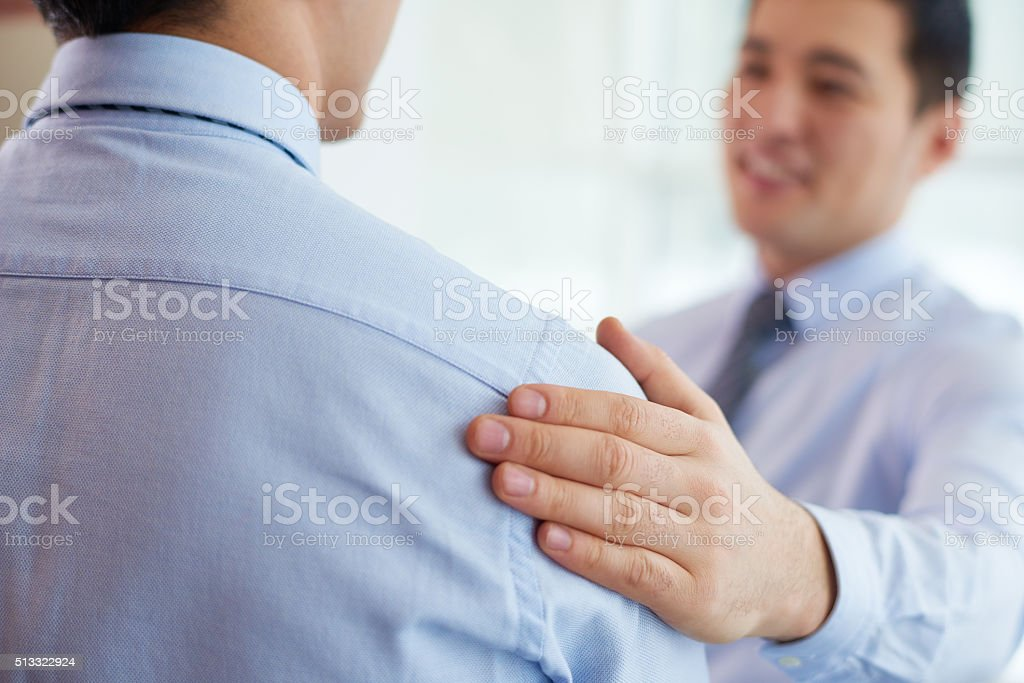 Congratulating colleague with success stock photo