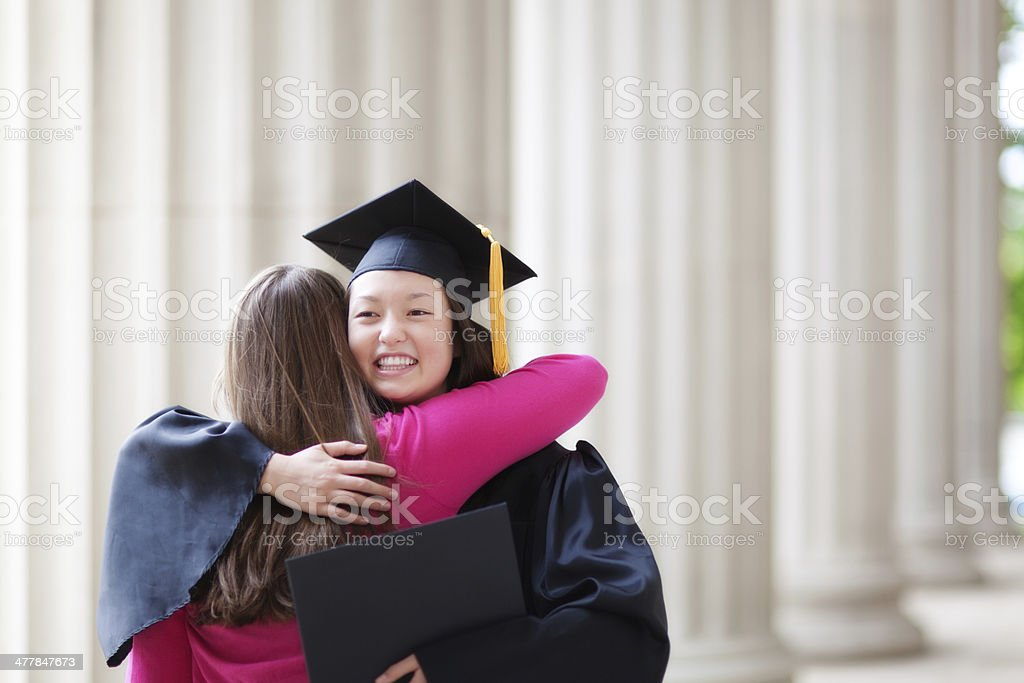 Congratulating Young Graduating Student in Graduation Ceremony Horizontal royalty-free stock photo