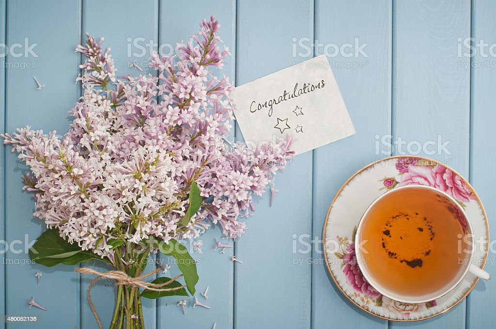 Congratulations card in summer bouquet of gentle blooming lilac stock photo