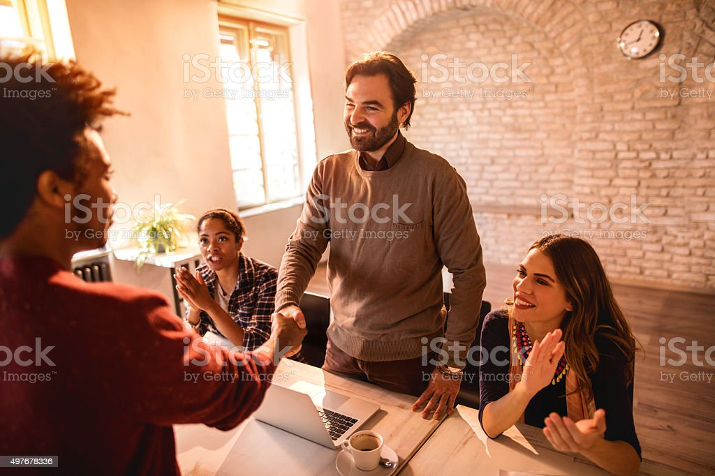 Congratulations, welcome to our successful business team! stock photo