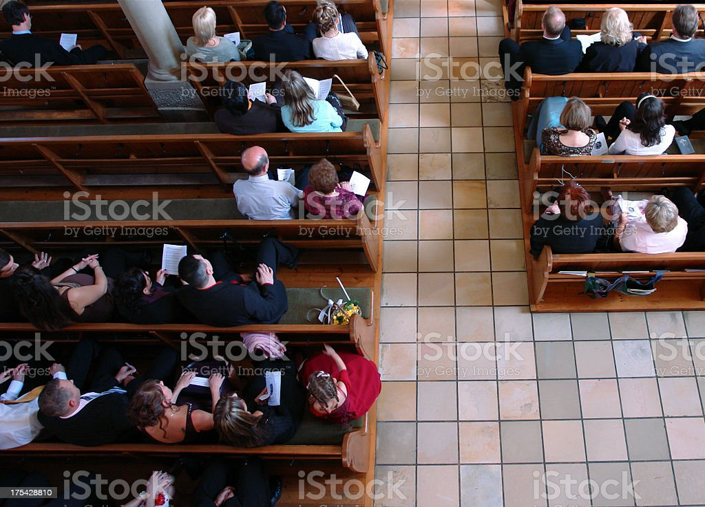 Congregation at church praying stock photo