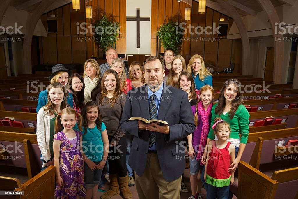 A congregation inside a Christian church stock photo