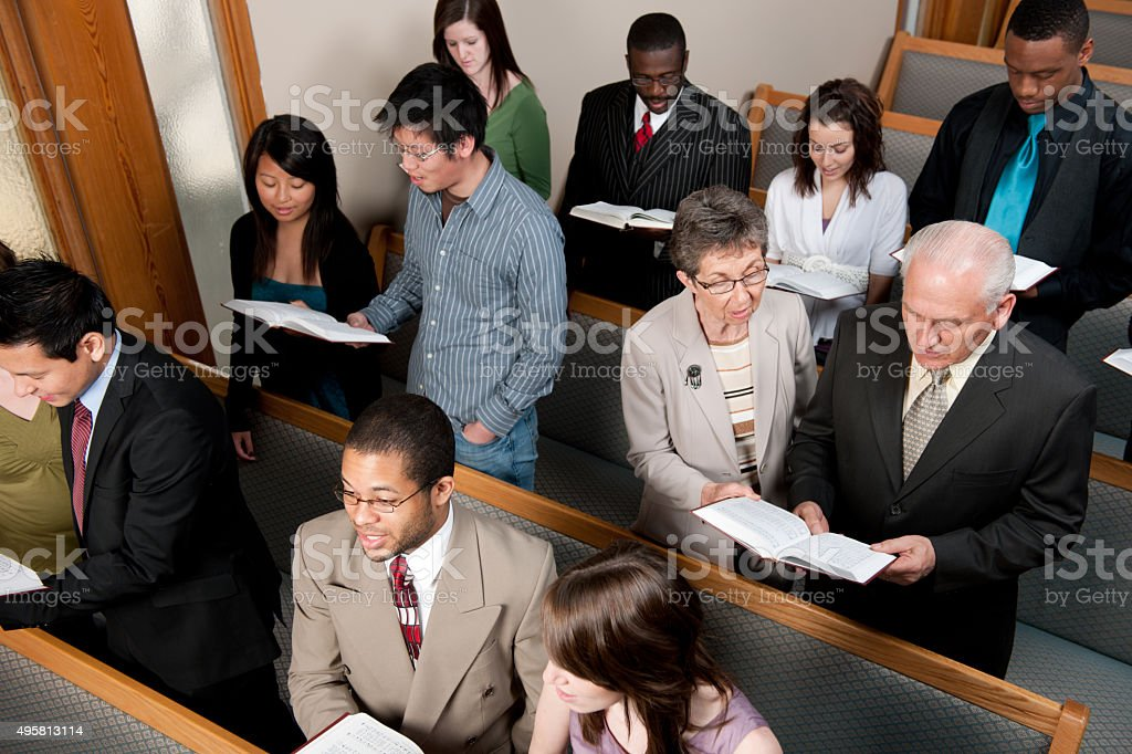 Congregation Singing Hymns in Church stock photo
