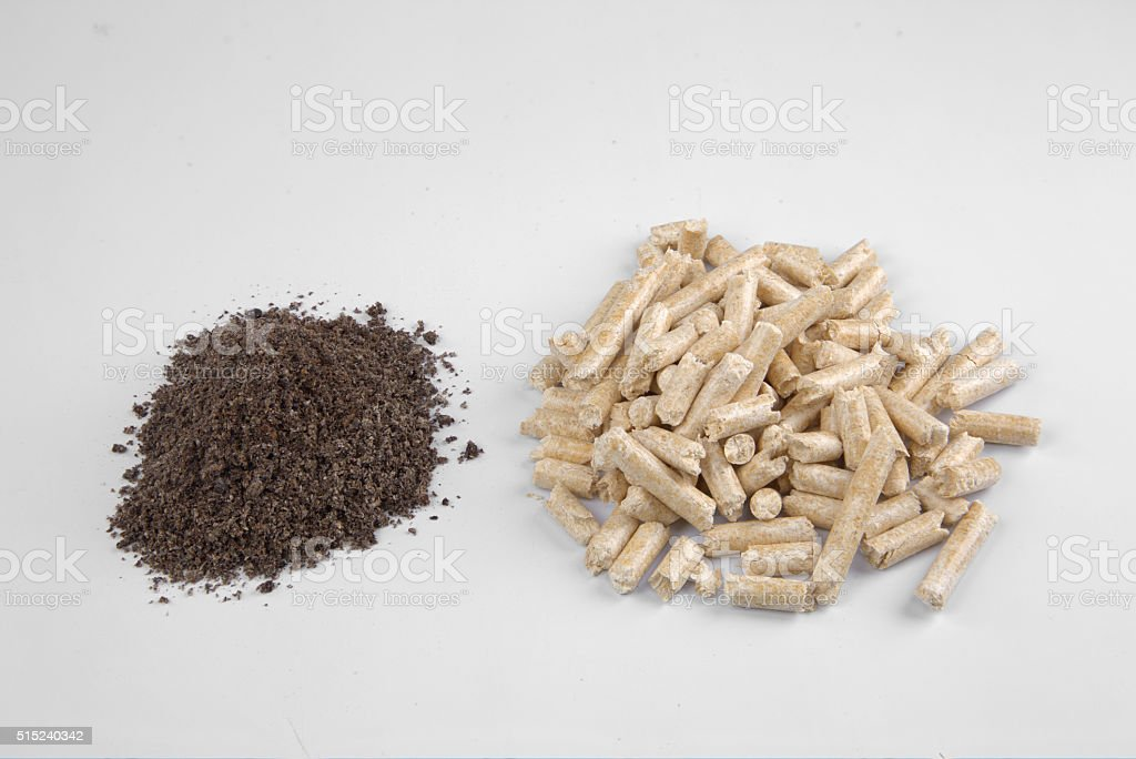 Conifer wood pellets and their ash stock photo