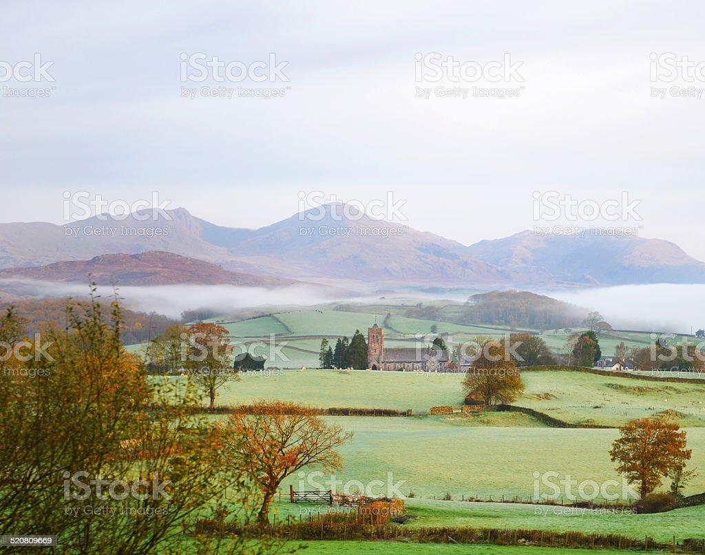 Coniston Church at Dawn in Pastel Shades stock photo