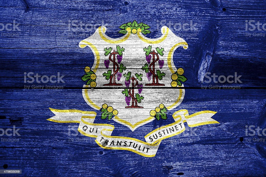 Connecticut State Flag painted on old wood plank texture royalty-free stock photo