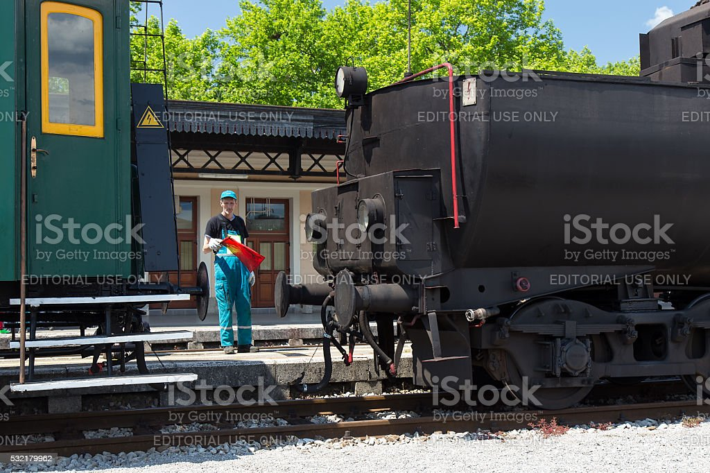 Connecting Old Steam Locomotive and passanger car on Railway station stock photo