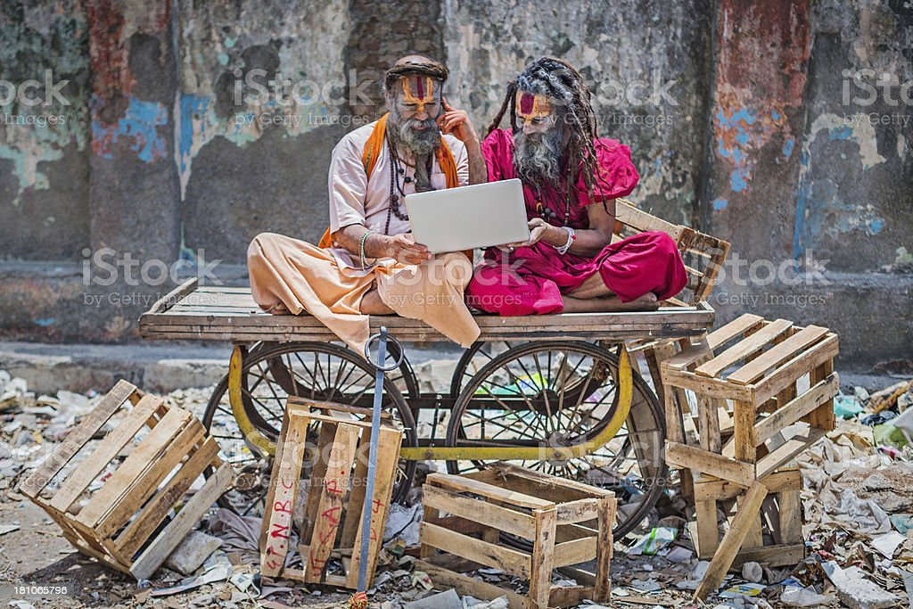 Two Indian residents exploring the power of internet and mobile phone.