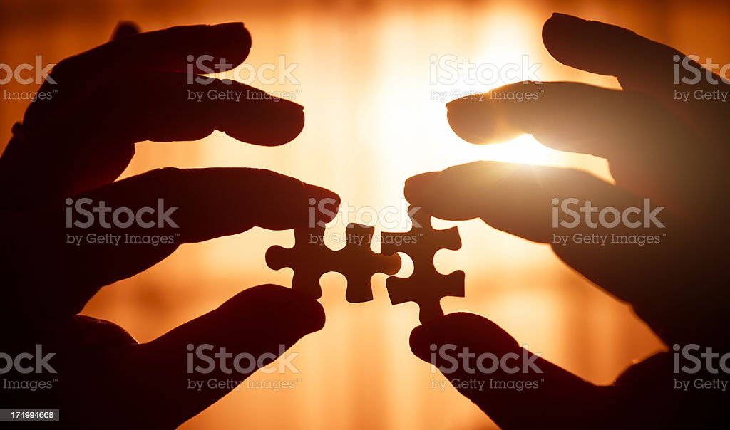 Connecting the piece of puzzle royalty-free stock photo