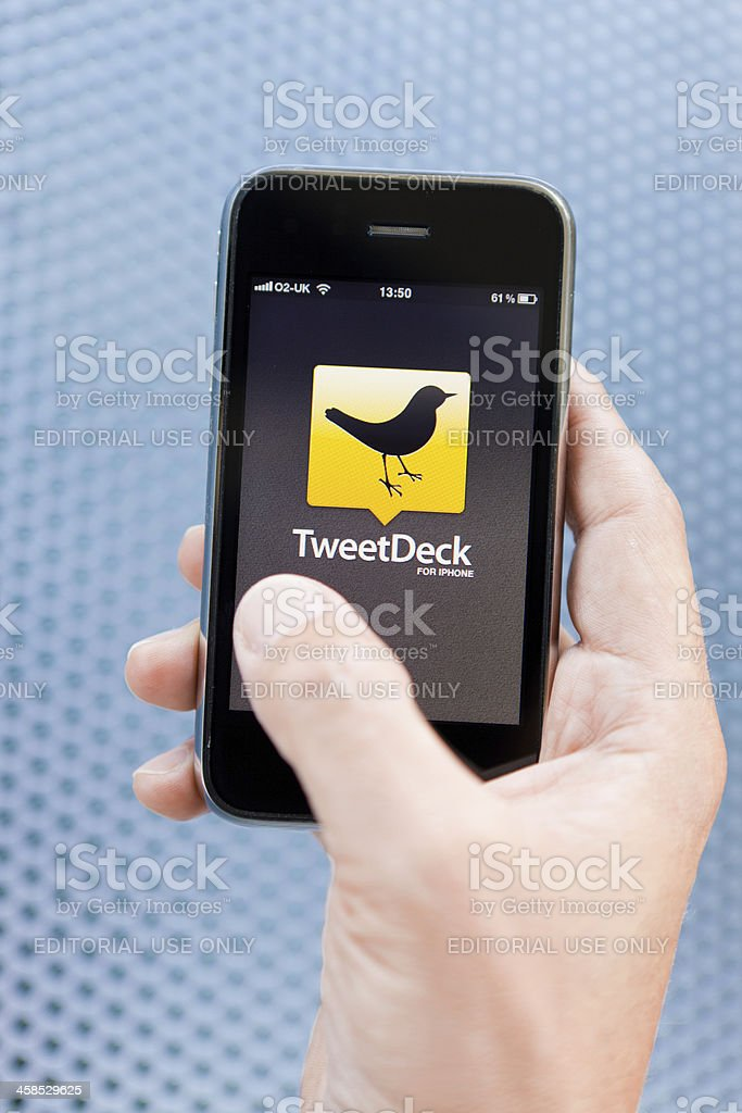 Connecting to TweetDeck with an iPhone royalty-free stock photo