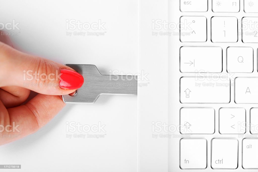 connecting USB flash drive in white laptop stock photo