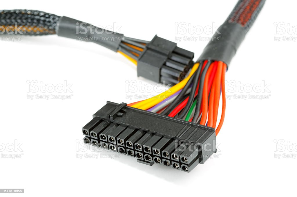 connecting wires to a computer on a white background stock photo