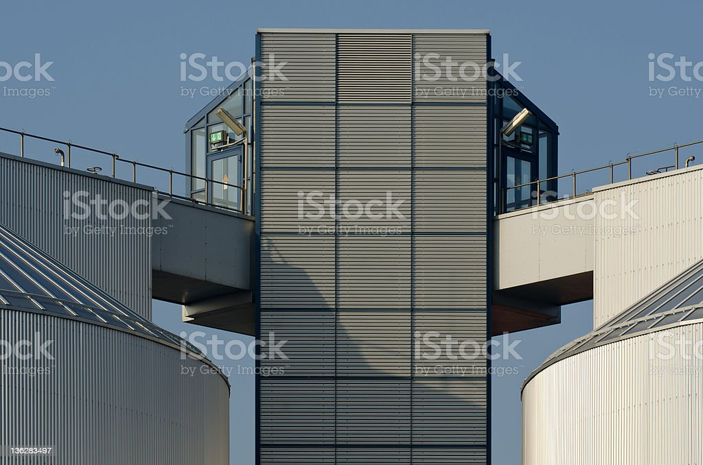 Connection of two silos, an industrial plant stock photo
