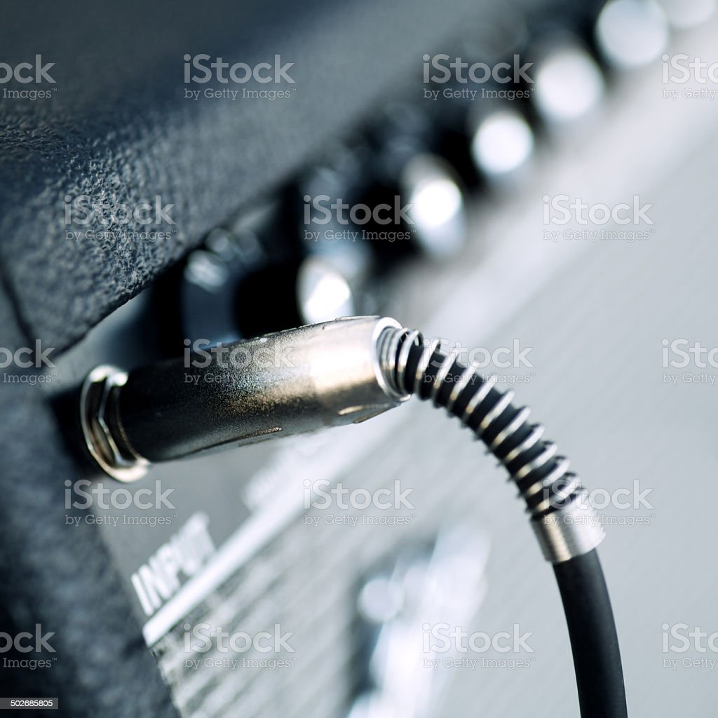 Connectors are connected in audio inputs Guitar amplifier stock photo