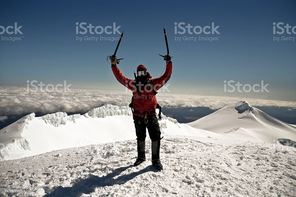 Conquered. Mountain climber on top stock photo