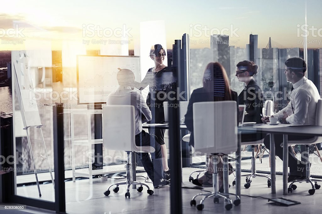 Conquering the city from the boardroom stock photo