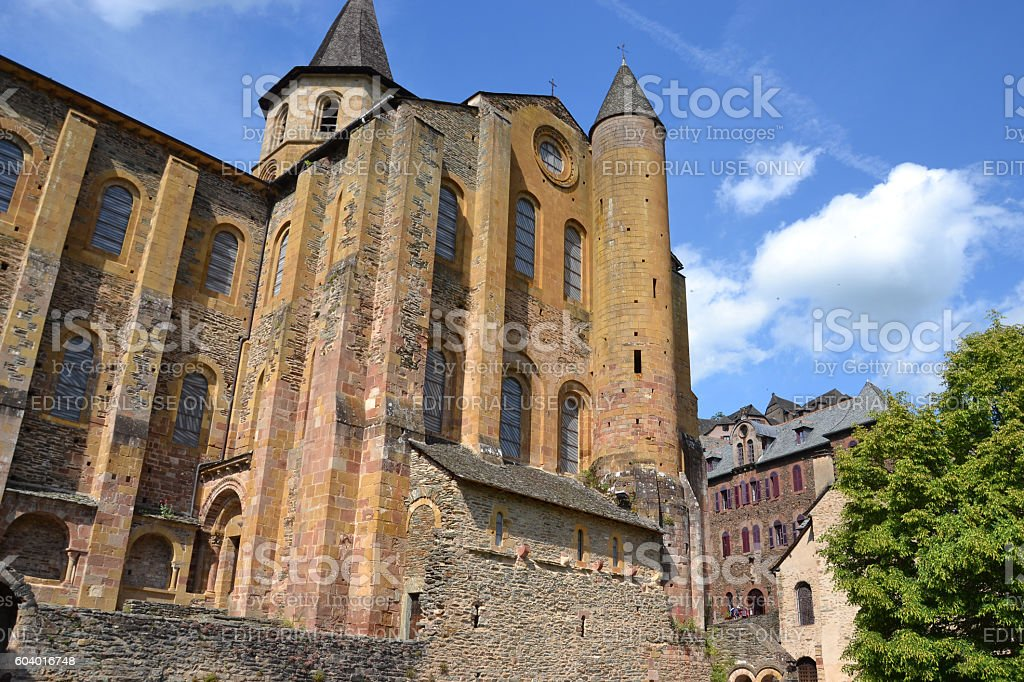 Conques church buildings in sunlight. stock photo