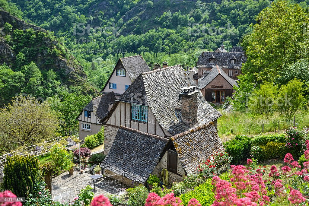 Conques town buildings in sunlight. stock photo