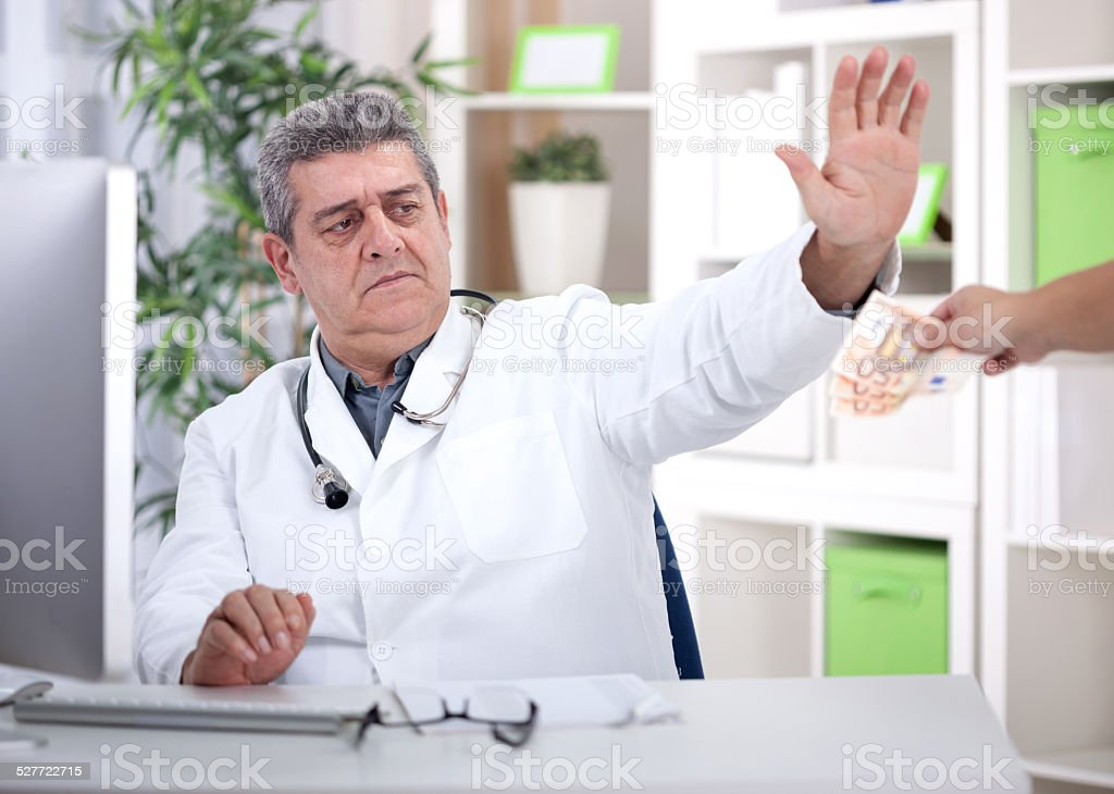 conscience senior doctor refuses bribes from patients stock photo