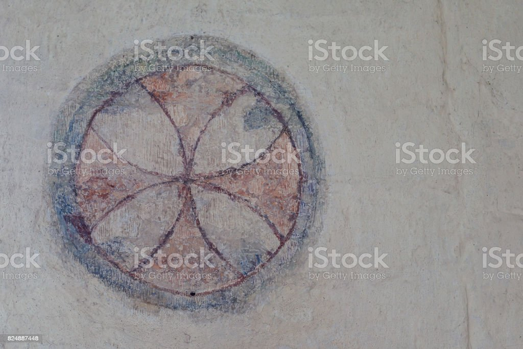 Consecration cross, a romanesque wall-painting stock photo