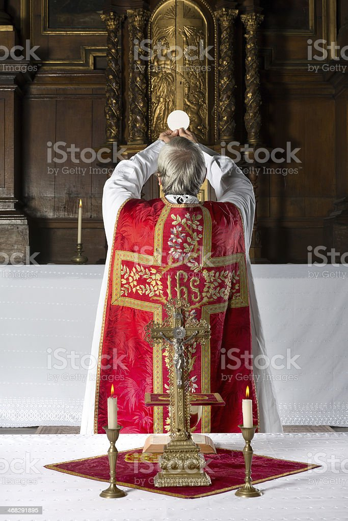 Consecration the old way stock photo