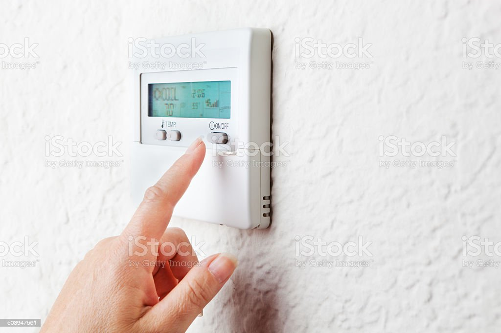 Conserving Energy by Controlling Indoor Temperature stock photo