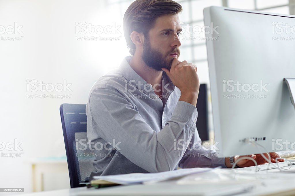 Considering his options stock photo