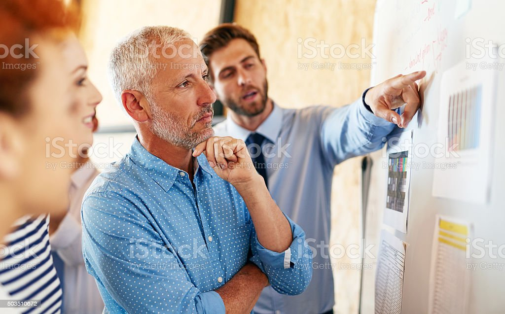 Considering their options stock photo