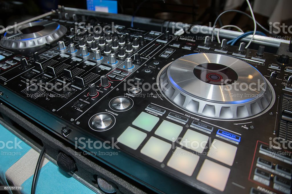 DJ console, CD player and mixer in nightclub stock photo