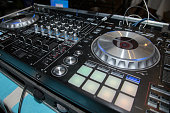 DJ console, CD player and mixer in nightclub